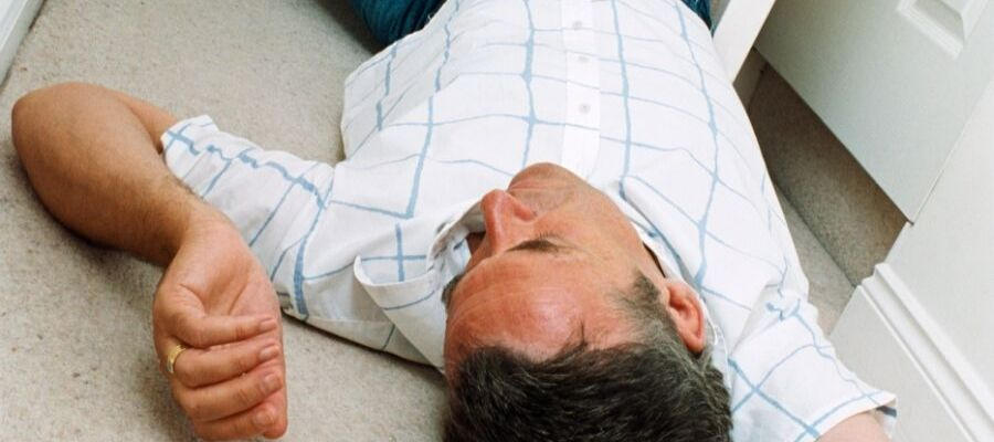 man lying down fainted from dehydration