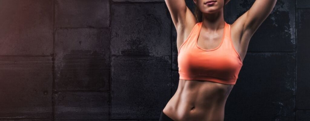 fit woman showing lean body
