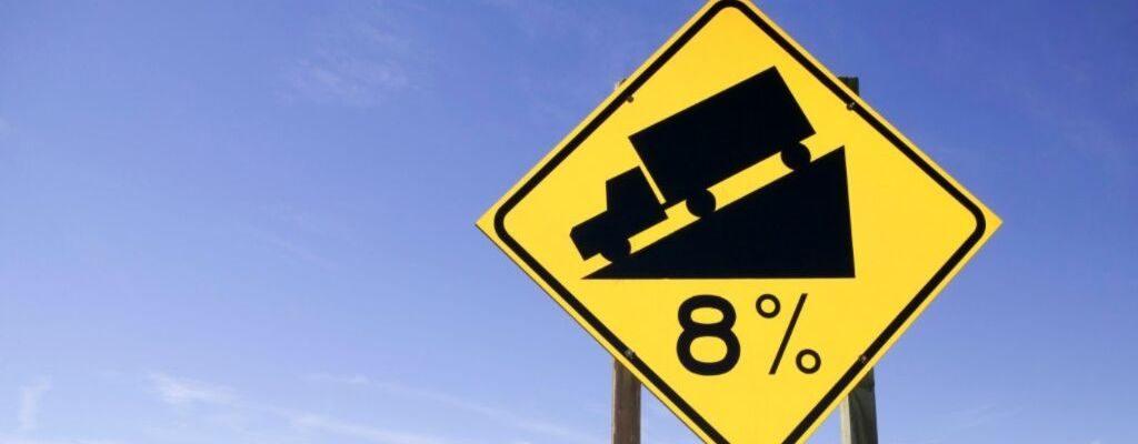 steep road ahead sign