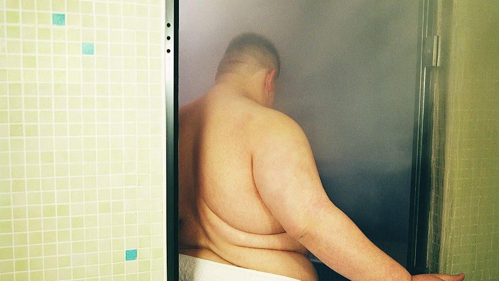 fat man going in a sauna
