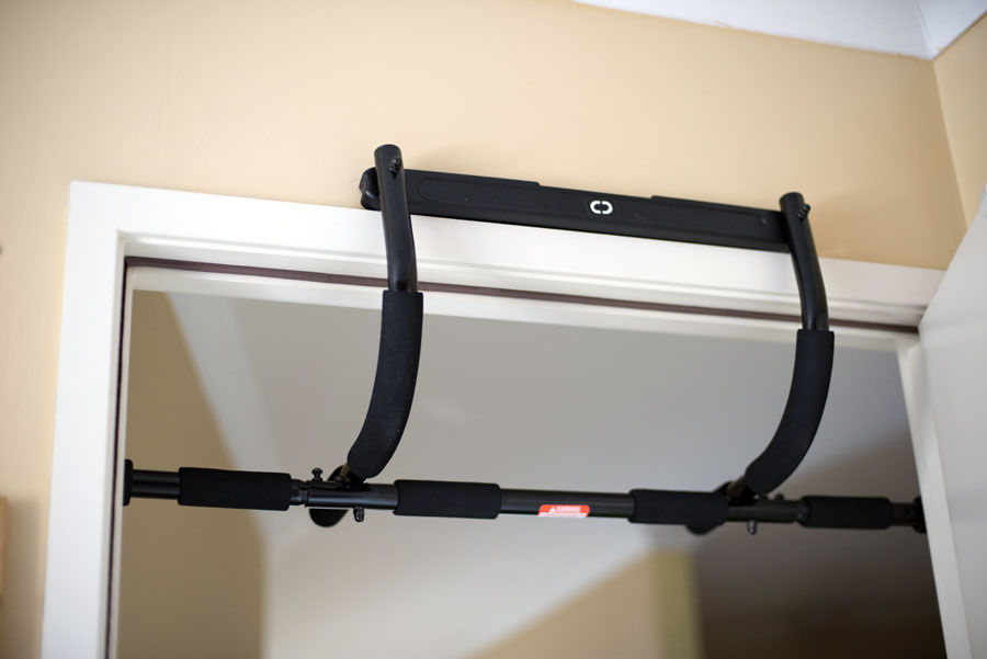 Pull up bar attached to door