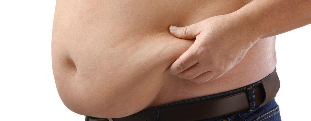 male pinching belly fat