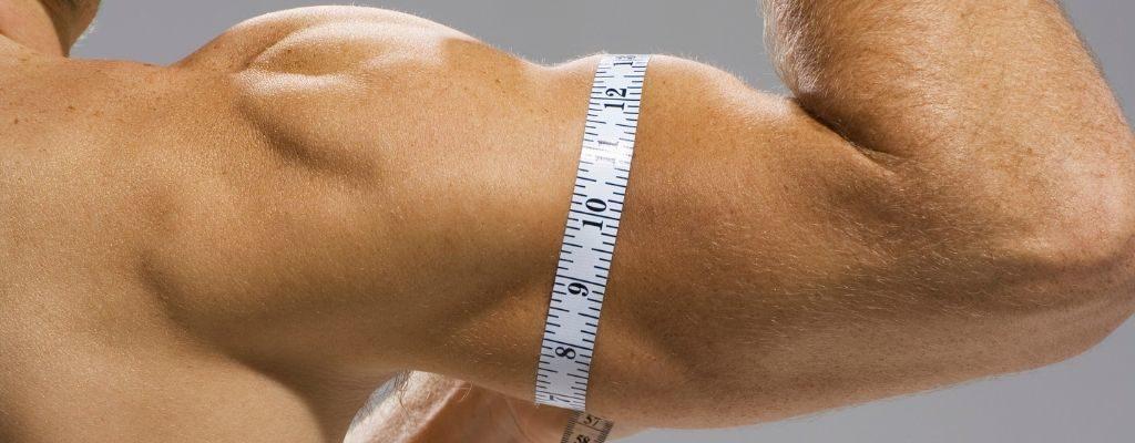 man measuring bicep