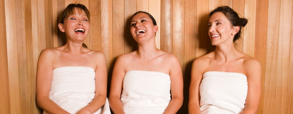 3 women enjoying sauna