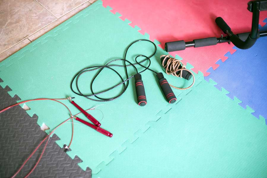 Photo of three jump ropes on an exercise mat