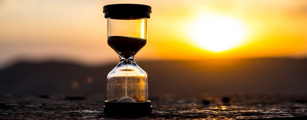 hourglass with a sunset background