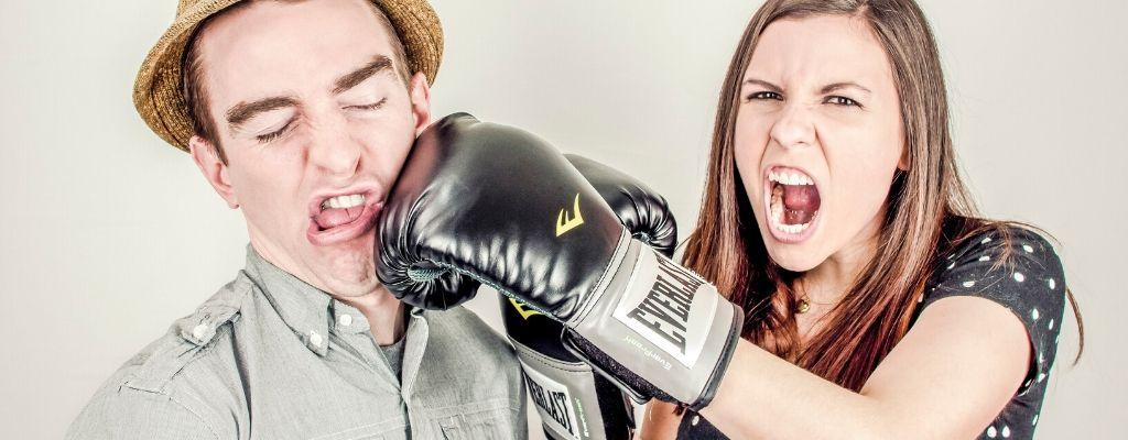 girl punching man